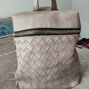 Madison West weave pleather backpack